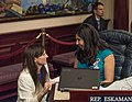 Anna Eskamani and Margaret Good confer on the House floor.jpg