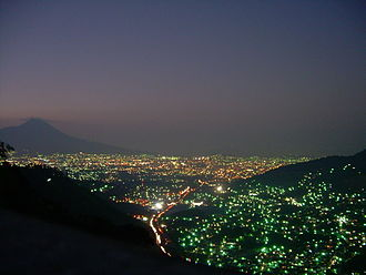 San Salvador - San Salvador as darkness descends on the greater metropolitan area.