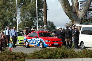 Australian Federal Police - A traffic operations vehicle, with traffic operations and other officers in ceremonial dress at the 2008 national Anzac Day service at the Australian War Memorial in Canberra.