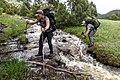 Backpackers cross an unnamed stream near Little Cottonwood Creek (27587563897).jpg
