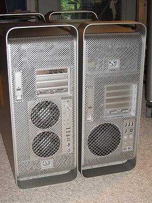 Mac Pro - The backs of a Power Mac G5 (left) and a Mac Pro (right) show the differences in arrangement. Note the dual fans on the Power Mac and the single fan on the Mac Pro as well as the new I/O port arrangement.