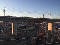 Beijing-Guangzhou HSR crossing above 101 Railway (20160325063428).jpg