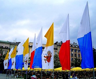 Flag of Poland - Polish (white and red), papal (yellow and white) and Marian or municipal (white and blue) flags in Kraków's Grand Square during Pope Benedict XVI's visit to Poland on May 27, 2006.