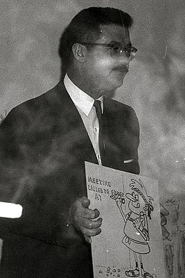 Bill Scott, voice actor, holding one of his drawings.jpg