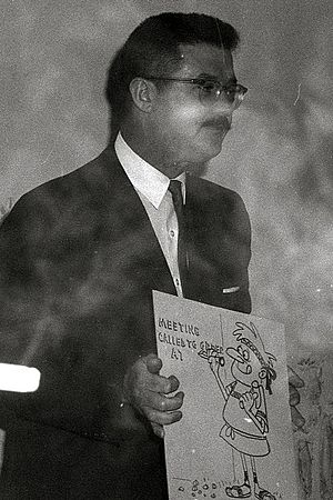 Bill Scott (voice actor) - Scott holding one of his drawings, 1962.