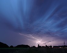 a return stroke cloud to ground lightning strike during a thunderstorm