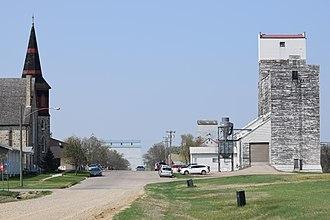 Boissevain, Manitoba - Church and elevators, in Boissevain.