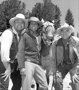 Dan Blocker (Hoss), Michael Landon (Little Joe), Lorne Greene (Ben) and one of the Bonanza horses. Bonanza cast smiling horse 1968.JPG