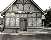"Side of the train station; sign reading ""Briarcliff Manor"""