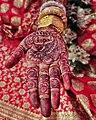 Brides hand full of Mehendi.jpg