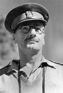 Brigadier R.J.H. Risson DSO, OBE, Chief Engineer, 2nd Australian Corp, watching a military demonstration of tank and infantry attack methods at Atherton Tablelands, QLD, 1943