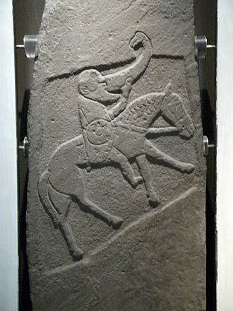 Torrs Pony-cap and Horns - The Pictish Bullion Stone, with drinking-horn terminated in a bird's head, Angus, 10th century AD
