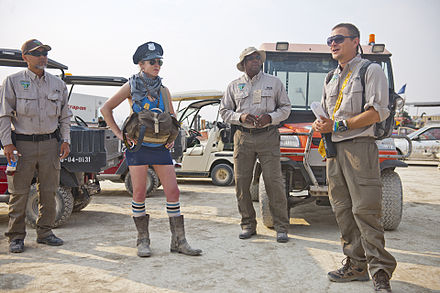 Bureau of Land Management officers and a Ranger at Burning Man Burning Man 2013 Cargo Cult (9625733758) (3).jpg