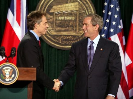 Tony Blair (left) and George W. Bush at Camp David in March 2003, during the build-up to the invasion of Iraq Bush and Blair at Camp David.jpg