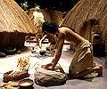 Cahokia diorama of woman grinding maize HRoe 2010.jpg