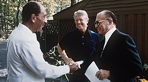 Egypt–Israel Peace Treaty - Menachem Begin, Jimmy Carter and Anwar Sadat at Camp David, 1978.