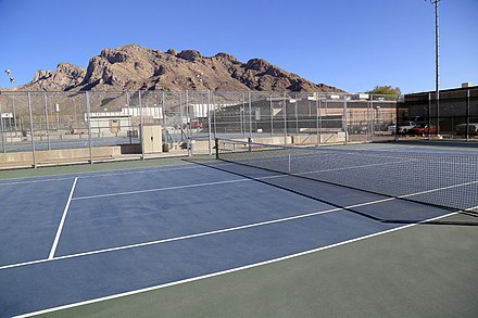 This is a picture of the Canyon Del Oro High School tennis courts in Oro Valley. Pusch Ridge is in the background. Canyon Del Oro High School.jpg
