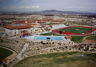 Cathedral Catholic High School - An aerial shot of CCHS's athletic facilities. In the far bottom left is part of right field of the baseball diamond. At the bottom is the multipurpose practice field. In the center is the pool. On the right is left field of the softball diamond. Manchester Stadium (track and turf field) is visible in the background. The Claver Center (basketball/volleyball court, wrestling room) is opposite Manchester.