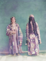 Central Asian Women's Adornment and Clothing. Two Women Wearing Long Robes. One Woman's Hair Is Arranged in Short, Jewel-Bedecked Braids; the Other Has Long, Thick Braids Down Her Back WDL11191.png