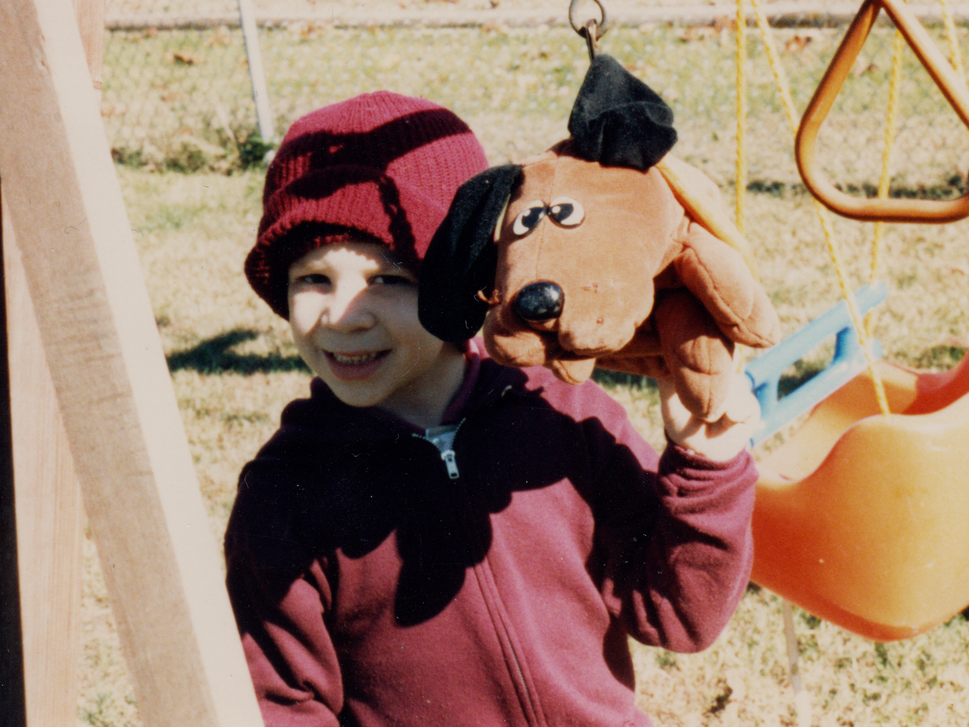 Child with Pound Puppies toy