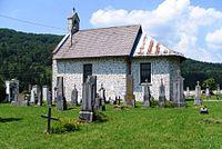 Church and cemetery in Koprivnik (Kocevje) Slovenia.JPG