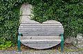 Churchyard wall with roman spolia, Fladnitz an der Teichalm - Styrian bench.jpg