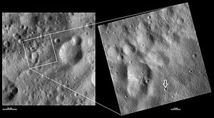 4 Vesta - Claudia crater (indicated by the arrow at the bottom of the closeup image at right) defines the prime meridian in the Dawn/NASA coordinate system.
