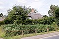 Concrete post fence and house, High Street Henham Essex England.jpg