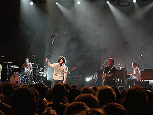 Counting Crows - Counting Crows in Brussels, 2008. L to R: Bogios, Duritz, Immerglück, and Gillingham. Vickrey is cut off at the left, Powers is behind Duritz, and Bryson is out of frame.