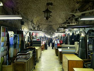 Souq al-Dira', maintaining its traditional role as a tailoring centre Covered Suq of Aleppo2.JPG