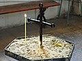 Cross and Votive Candle in Church - Telavi - Georgia (18202003789).jpg