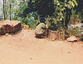 Crouching young female Thailand.jpg
