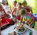 Cutting skull birthday cake for 11 year old. Cooktown. 2016.jpg