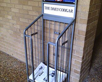 The Daily Cougar - A Daily Cougar distribution stand on the University of Houston campus