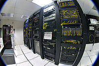 Racks of telecommunications equipment in part of a data center.