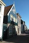 foto van Huis met zadeldak en houten topgevel