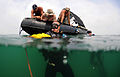 Defense.gov News Photo 100530-N-0413B-027 - U.S. Navy sailors from Mobile Diving and Salvage Unit 1 check the manifold of Petty Officer 2nd Class Brody Dorton s center scuba tanks before his.jpg