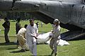 Defense.gov News Photo 100818-M-3497D-688 - U.S. Marine Capt. Paul D. Duncan assists a Pakistani civilian unloading a U.S. Marine Corps CH-53E Super Stallion helicopter during humanitarian.jpg