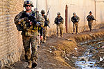Defense.gov News Photo 120128-F-SA682-088 - U.S. troops walk to the Department of Public Works facility and a water distribution point to inspect a project in Kandahar province Afghanistan.jpg
