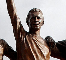 A head and upper shoulders shot of a statue of a footballer