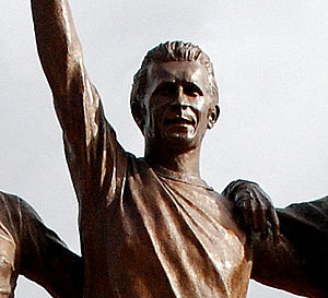 "Denis Law - Law as depicted on a statue at Old Trafford which honours him, George Best and Bobby Charlton as the ""United Trinity"""