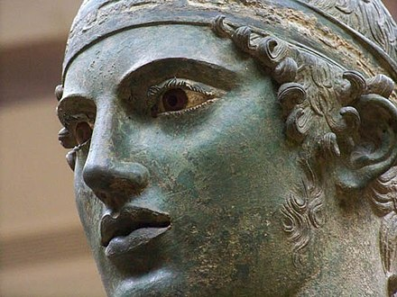 Close-up of the Charioteer of Delphi, a celebrated statue from the 5th century BC. Detail of the Charioteer, Delphi (4691931414).jpg