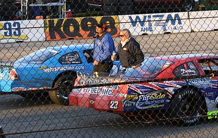 Trickle (right) at the 2009 Dick Trickle 99 DickTrickleWalkingLaCrosseSpeedway2009.jpg