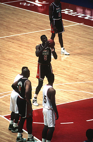 "1992 Summer Olympics - The 1992 Summer Olympics allowed NBA players to participate in the basketball competition for the first time; here David Robinson shoots a free throw for the gold-medal winning United States ""Dream Team""."