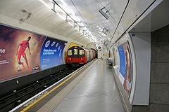 Embankment tube station, Northern Line train departing, 8 June 2013.jpg
