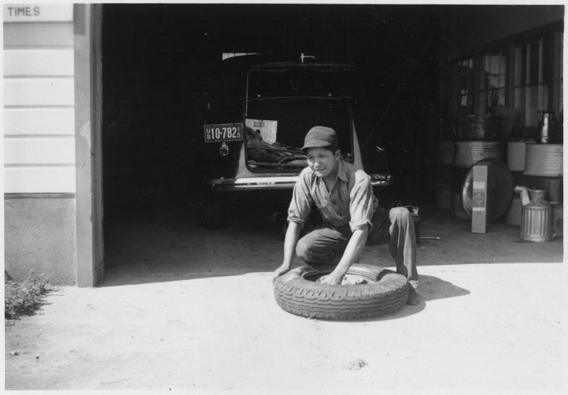 File:Emmet Jones, former CCC enrollee, working on tire - NARA - 285887.tif