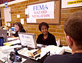 FEMA - 30705 - FEMA representative speaks with disaster victim.jpg
