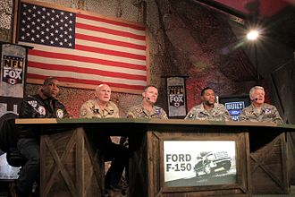 Fox Sports (United States) - Fox NFL Sunday presenter Curt Menefee pictured with pundits Terry Bradshaw, Howie Long, Michael Strahan and Jimmy Johnson during a 2009 broadcast of the show in Afghanistan.
