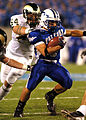 Falcon running back is tackled.jpg