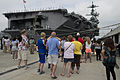 Family and friends of U.S. Sailors aboard the aircraft carrier USS Harry S. Truman (CVN 75) watch as the ship departs Naval Station Norfolk, Va., July 22, 2013 120722-N-BD629-028.jpg